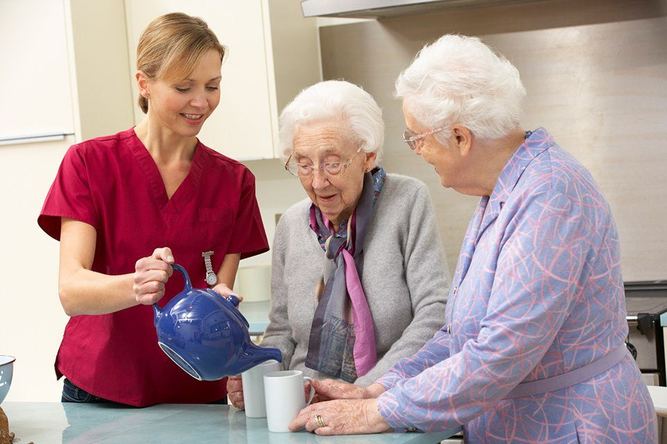 woman helping out 2 senior women with their coffee