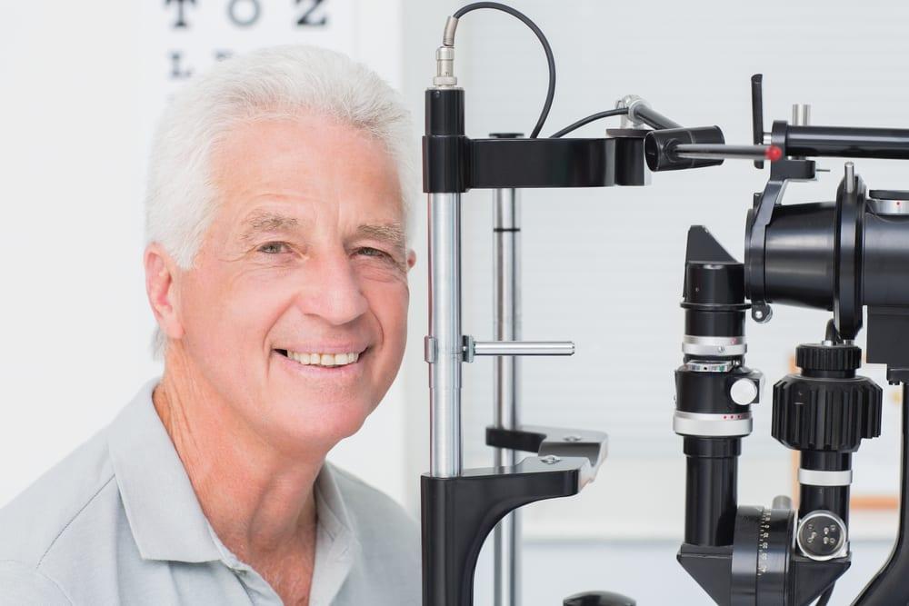 smiling senior man at eye exam
